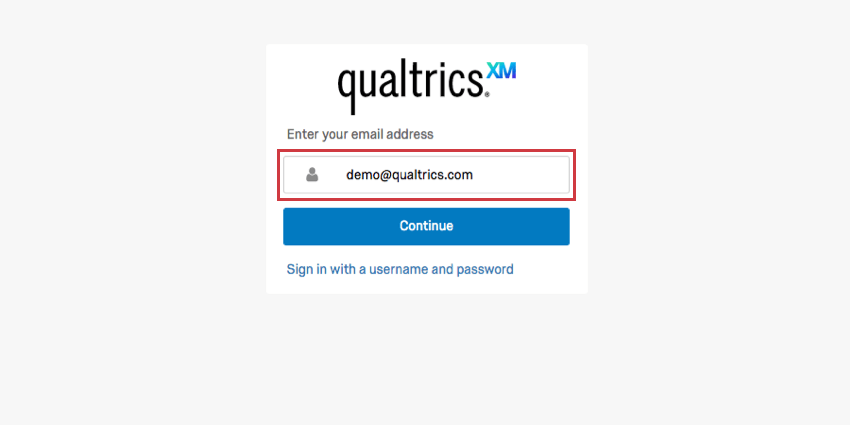 Email address in the field, blue continue button below
