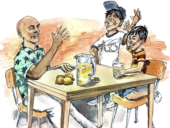 A man and his sons talking around the table